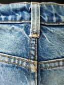 Vintage jeans with seams background — Stockfoto