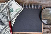 Magnifying glass on american dollars — Stock Photo