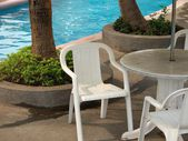 Beach chair and swimming pool — Foto Stock