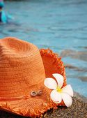 Hat on the poolside — Stock Photo