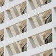 Building facade with window in angle — Stock Photo