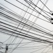 Stock Photo: Untidy electrical wire on pole