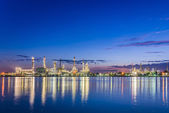 Twilight at petroleum refinery along the river — Stock Photo