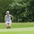 Michelle Wie looks for putting line — Stok fotoğraf