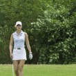 Michelle Wie walks on green — Foto Stock