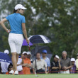 Stock Photo: LorenOchowaits to putt