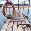 Gangway over the water and a lifebuoy — ストック写真