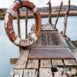 Stock Photo: Gangway over water and lifebuoy
