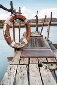Gangway over the water and a lifebuoy — Stock Photo