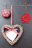 Christmas ornament: christmas ball, red snowflake and a wooden h — Stock Photo
