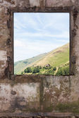 Old room and a landscape view through the window — Stock Photo