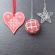 Christmas ornament: christmas ball, silvered star and a red hear — Stock Photo #14551601