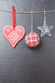 Christmas ornament: christmas ball, silvered star and a red hear — Stock Photo