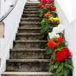 Staircase decorated with colorful flowers — Stock Photo