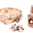 Stock Photo: Old beech wood nutcracker with and nutshell with walnut in woode