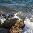 Waves crashing on rocks — Stock Photo #27455603