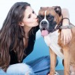Young woman Kissing  her  dog . Boxer dog. — Stock Photo