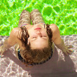 Summer woman by pool — Stock Photo