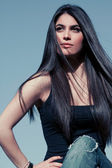 Woman with long shine black hair — Stock Photo