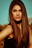 Exotis portrait of beautiful long hair woman on sun. — Stock Photo