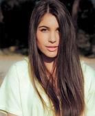 Beauty portrait of young hispanic woman with long shiny black hair. — Stock Photo