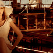 Elegant Lady wear hat and lace dress , sitting near the wooden yachts . — Stock Photo #26783793