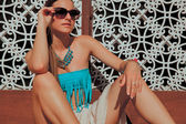 Fashion portrait of attractive woman with accessories and sunglasses in summer outfits. — Stock Photo