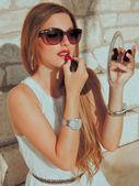 Seductive woman doing make up — Stock Photo