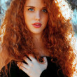 Stock Photo: Red hair Beauty. vertical shot , outdoors