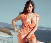 Attractive fashion woman in elegant dress. — Stock Photo