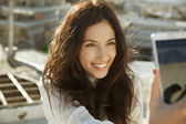Smiling girl take a picture, selfie style — Stock Photo