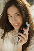 Pretty woman with smartphone — Stock Photo