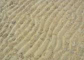 Strand sand ripple muster und krabben loch — Stockfoto