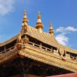 Tibetan temple gilt roof - Stock Photo