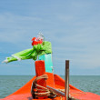 Stock Photo: Wooden orange boat sailing