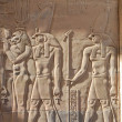 Egyptian engraved gods image on wall - Stock Photo