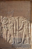 Egyptian engraved gods image on wall — Stock Photo