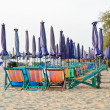 Colorful beach chairs - Stock Photo