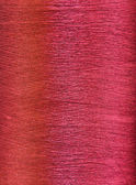 Red silk thread in spool — Stock Photo