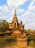 Walking Buddha statue — Stock fotografie