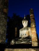 Ancient buddha statue at twilight — Stock Photo