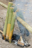 Rice cooking in bamboo stalk — Stock Photo