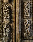 Burmese wooden carving temple door — Stock Photo