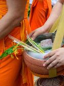 Monks receiving flower offering — Stock Photo