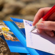 Ansichtskarte schreiben - writing a picture postcard 04 — Stock Photo