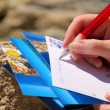 Writing a picture postcard — Stock Photo