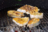 Grilling steak from fish — Stock Photo