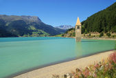 Reschensee with church — Stock Photo