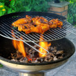 Foto Stock: Grilling chicken