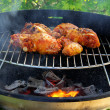 Foto Stock: Grilling chicken 03